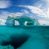 Canada, Nunavut Territory, Repulse Bay, Underwater view of melting iceberg in Harbour Islands on Hudson Bay just south of arctic circle