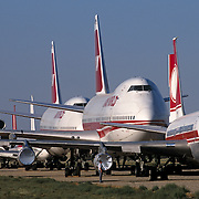 Stored old airliners sit in mid-day heat of arid Sonoran Desert at Mojave airport facility, awaiting recycling for scrap value