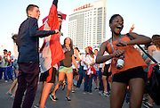 Athletes, team officials and others dance at the end of the closing ceremonies of the Internaitonal Children's Games in Windsor, Ontario.