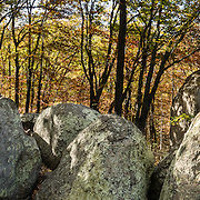 Indian Rocks, fall foliage color in mid October. Walk 0.3 miles to the impressive boulders of Indian Rocks from Indian Gap Parking Area (Milepost 47.5, elevation 2098 feet) on Blue Ridge Parkway, in Virginia, in the Blue Ridge Mountains (a subset of the Appalachian Mountains), USA. The scenic 469-mile Blue Ridge Parkway was built 1935-1987 to aesthetically connect Shenandoah National Park (in Virginia) with Great Smoky Mountains National Park in North Carolina, following crestlines and the Appalachian Trail. This panorama was stitched from 3 overlapping photos.