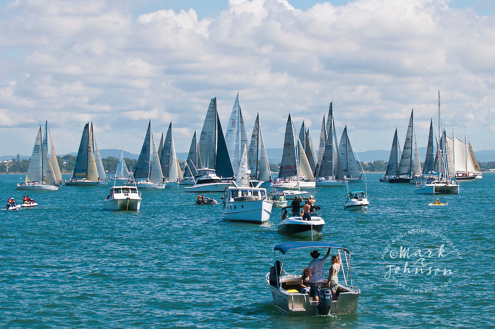 Sailboats and spectators in the Brisbane to Gladstone yacht race, Moreton Bay, Queensland, Australia