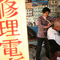 A Chinese man gets a haircut in a small village barbershop just outside of Dali, in the Yunnan province of China. (Photo/Scott Dalton)