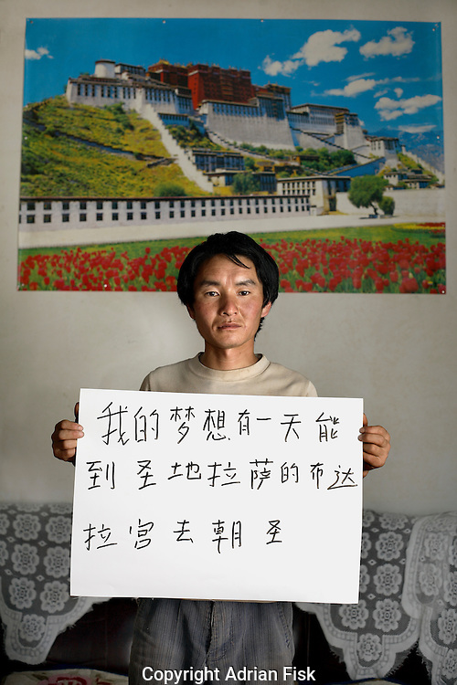 Qiang Chow - 25 Yrs.<br /> Construction worker.<br /> Qinghai Province.<br /> <br /> 'I dream that one day I can go to the holy Potala Palace in Lhasa for Pilgrimage'.