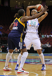 June 3, 2012; Newark, NJ, USA; New York Liberty forward Pienette Pierson (33) looks to pass while being defended by Indiana Fever forward Tamika Catchings (24) during the first half at the Prudential Center.