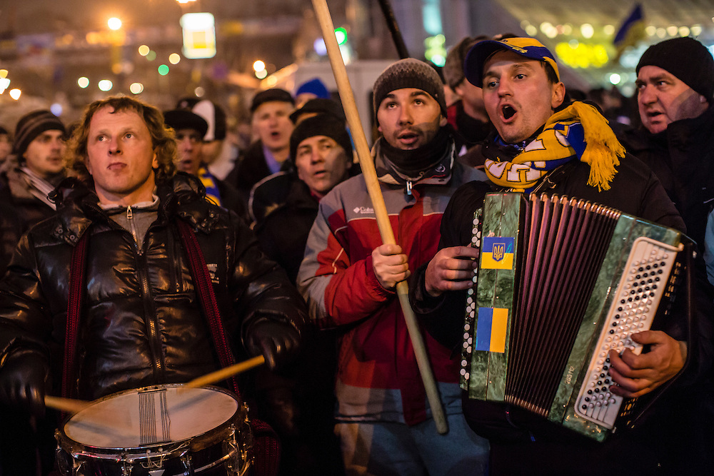 KIEV, UKRAINE - DECEMBER 12: A small band performs while walking around Independence Square during ongoing anti-government protests on December 12, 2013 in Kiev, Ukraine. Thousands of people have been protesting against the government since a decision by Ukrainian president Viktor Yanukovych to suspend a trade and partnership agreement with the European Union in favor of incentives from Russia. (Photo by Brendan Hoffman/Getty Images) *** Local Caption ***
