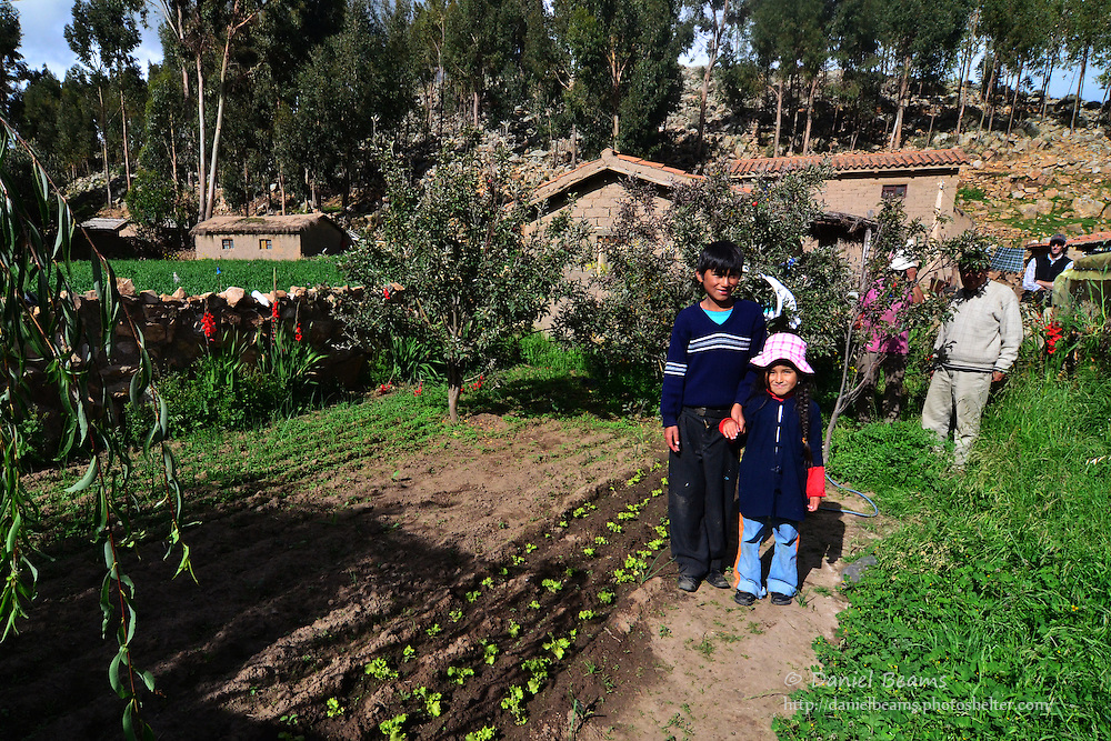 Quechua children in garden at 12,000 ft in the Andes, Cochabamba, Bolivia