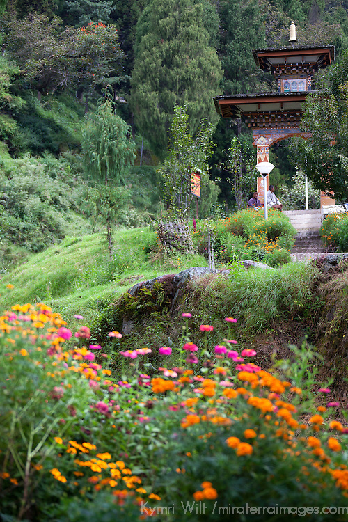 Asia, Bhutan, Trongsa. Trongsa Dzong Gate and Flowers.