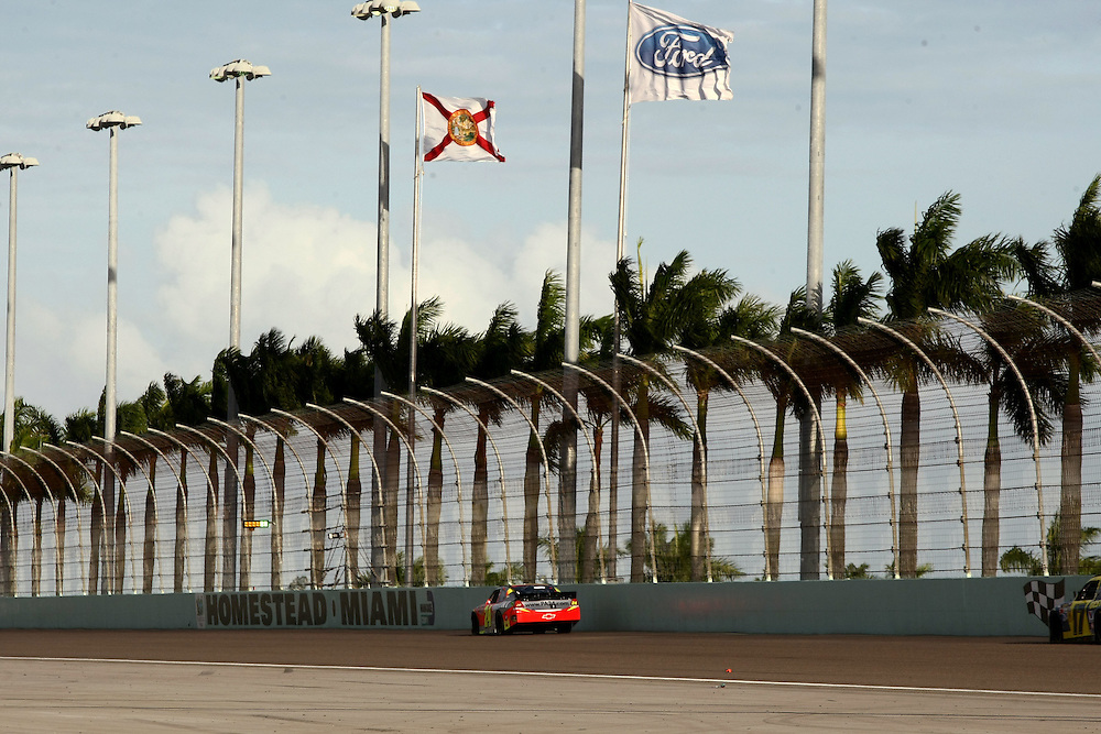 Nov 18, 2012; Homestead, FL, USA; NASCAR Sprint Cup Series driver Jeff Gordon (24) drives down the backstretch during the Ford EcoBoost 400 at Homestead Miami Speedway.  Mandatory Credit: Douglas Jones-DDJ Sports Imaging
