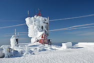 Contrails surrounding the Mount Washington Observatory tower.