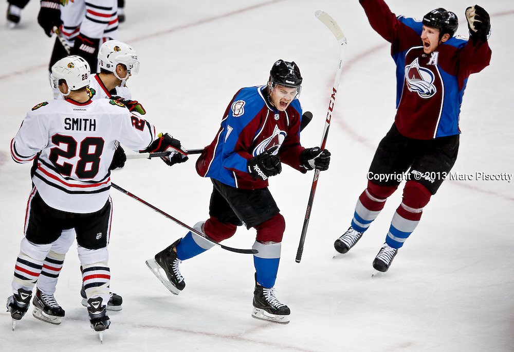 SHOT 11/19/13 8:30:06 PM - John Mitchell #7 of the Colorado Avalanche celebrates after scoring a goal against the Chicago Blackhawks during their regular season NHL game at the Pepsi Center in Denver, Co. on Tuesday November 19, 2013. The Avalanche won the game 5-1. (Photo by Marc Piscotty / © 2013)