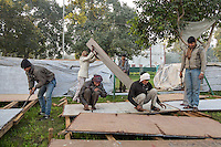 New Delhi, India: Workers dismantle the seating and scaffolding arrangements made for the crowds celebrating India's Republic Day and a visit from US President Barack Obama.