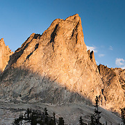 The pyramidal peak of El Capitan rises to 9846 feet or 3001 elevation in Sawtooth Wilderness, Blaine County, Idaho, USA. The Sawtooth Range (part of the Rocky Mountains) are made of pink granite of the 50 million year old Sawtooth batholith. Sawtooth Wilderness, managed by the US Forest Service within Sawtooth National Recreation Area, has some of the best air quality in the lower 48 states (says the US EPA).