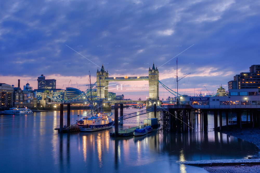 dusk falls over tower bridge in april 2010 in london england