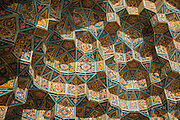 Ceramic tiles ceiling decorating a vault at Nasir al-Mulk Mosque, (aka the Pink Mosque) Shiraz, Iran. Built 1876 -1888. Architects: Muhammad Hasan-e-Memar and Muhammad Reza Kashi Paz-e-Shirazi.