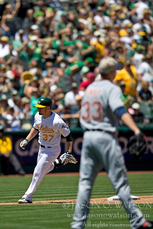 OAKLAND, CA - MAY 26:  Brandon Moss #37 of the Oakland Athletics rounds the bases after hitting a home run off of Drew Smyly #33 of the Detroit Tigers during the second inning at O.co Coliseum on May 26, 2014 in Oakland, California. (Photo by Jason O. Watson/Getty Images) *** Local Caption *** Brandon Moss; Drew Smyly