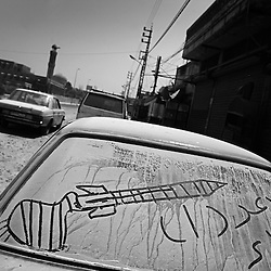 A drawing of a Raad 1 missile, said to be owned by Hezbollah, is drawn on a car in the dust from the incessant Israeli bombing in the city of Tyre, Lebanon, July 27, 2006.