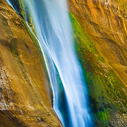 Desert waterfall and algae colored cliffs