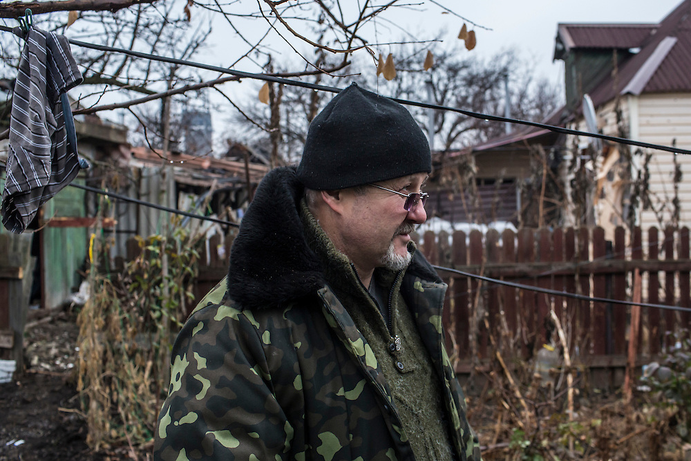 PIKSY, UKRAINE - NOVEMBER 19, 2014: Viktor G. Bondan, a doctor volunteering with the Dnipro-1 brigade, a pro-Ukraine militia, near the house he uses as a field hospital in Pisky, Ukraine. The village of Pisky is the scene of much of the front-line fighting over the Donetsk airport. CREDIT: Brendan Hoffman for The New York Times