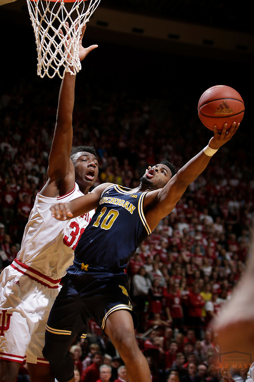 Michigan guard Derrick Walton Jr. (10) in action as Michigan played Indiana in an NCCA college basketball game in Bloomington, Ind., Sunday, Feb. 12, 2017. (AJ Mast)