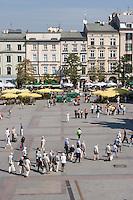 People walking on the Rynek in Krakow Poland