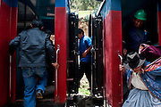 Passengers board the train at a station between Huancayo and Huancavelica.