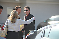 Paul Kevin Curtis (right), who had been in custody under suspicion of sending ricin-laced letters to President Barack Obama and others, hugs his attorneys Hal Nielson (left) and Christi McCoy on Tuesday, April 23, 2013 in Oxford, Miss. The charges were dismissed without prejudice, which means they could be re-instated if prosecutors so choose.