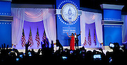 President Barack Obama and First Lady Michelle Obama wave to the crowd at the Inaugural Ball, January 21, 2013 in Washington, D.C.