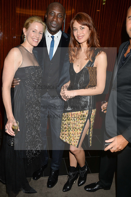 Left to right, SYDNEY INGLE-FINCH, OZWALD BOATENG, OLGA KURYLENKO and ? at a dinner hosted by Liberatum to honour Francis Ford Coppola held at the Bulgari Hotel & Residences, 171 Knightsbridge, London on 17th November 2014.