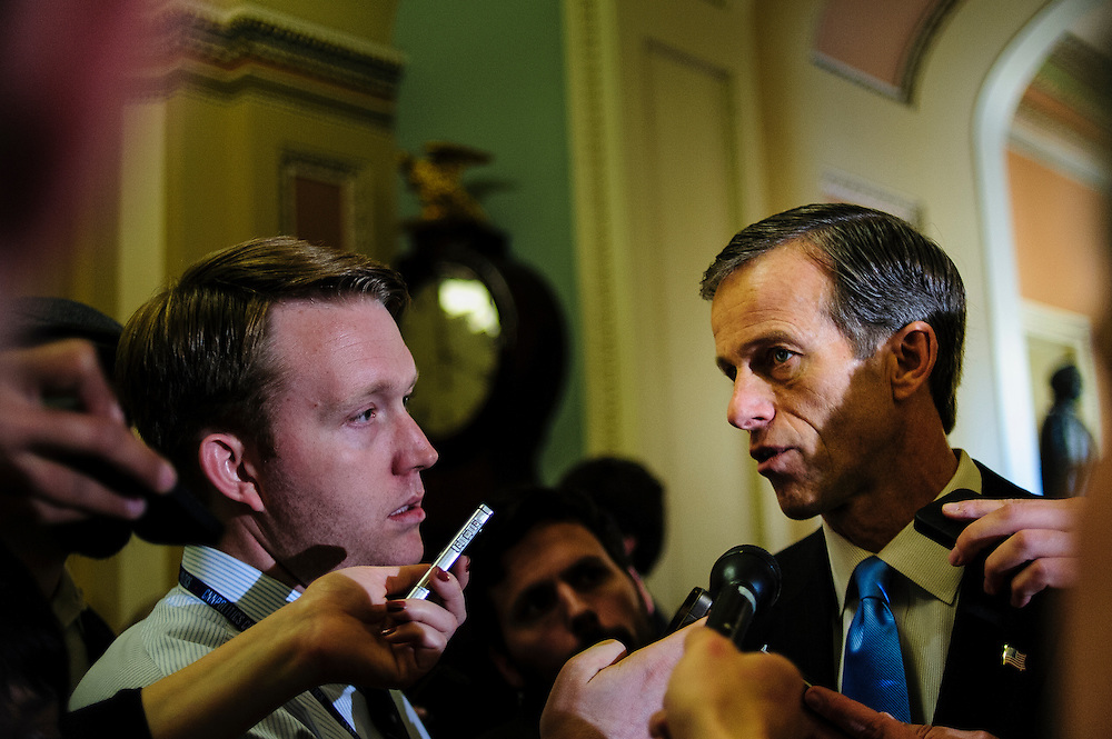 Senator John Thune (R-SD) is interviewed by reporters following a party caucus meeting at the U.S. Capitol. Fiscal cliff negotiations continue at the U.S. Capitol in Washington, District of Columbia, U.S., on Sunday, Dec. 30, 2012. A combination of spending cuts and tax increases are set to kick in within hours unless congressional Republicans and Democrats cut a last-minute deal. Photographer: Pete Marovich/Bloomberg