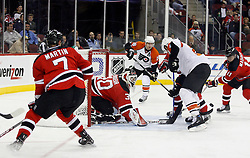 November 8, 2007; Newark, NJ, USA; New Jersey Devils goalie Martin Brodeur (30) and Philadelphia Flyers right wing Mike Knuble (22) look for the loose puck during the third period at the Prudential Center in Newark, NJ.