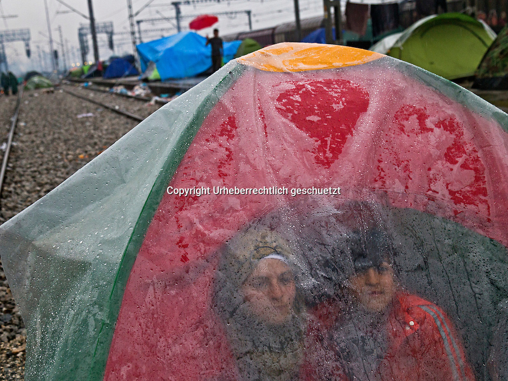 Greece, Idomeni, Refugees on their way to Europe - Eye of a Needle, Idomeni<br /> <br /> Syrian family behind a plastic plane, hidding themself for the heavy rain in there tent.<br /> <br /> Nadeloehr nach Nordeuropa Idomeni, der Grenzuebergang ist seit Tagen gesperrt,. <br /> Es ensteht im provisorischen Fluechtlingslager in Idomeni eine ngespannte Lage. <br /> Daueregen und Kaelte machen vor allem den Familien mit kleinen Kindern zu schaffen. <br /> <br /> Idomeni, is the eye of a needle for getting to nothern Europe. <br /> The FYRO macedonian authorities, closed the border from Greece completely. The situation close to the border gets more and more difficult. The People have to sleep outside or in small tents. <br /> Heavy rainfalls and cold nights are treating the refugees badly. Some already stayed up to ten nights at Idomeni. There is not enough food and supplies to help about 14.000 refugees.<br /> <br /> <br /> <br /> keine Veroeffentlichung unter 50 Euro*** Bitte auf moegliche weitere Vermerke achten***Maximale Online-Nutzungsdauer: 12 Monate !! <br /> <br /> for international use:<br /> Murat Tueremis<br /> C O M M E R Z  B A N K   A G , C o l o g n e ,  G e r m a n y<br /> IBAN: DE 04 370 800 40 033 99 679 00<br /> SWIFT-BIC: COBADEFFXXX