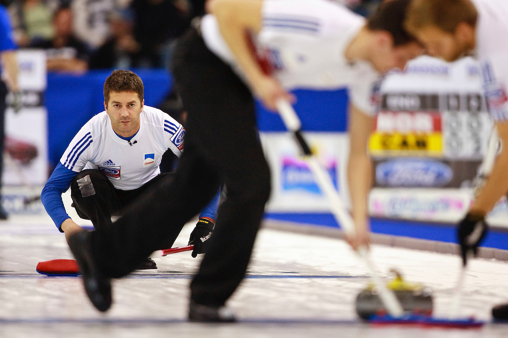 France's skip Thomas Dufour, watches his shot during the last end of their  9-7 win over the United States in the evening draw at the Ford World Men's Curling Championships at the Brandt Centre in Regina, Saskatchewan, April 7, 2011.<br /> AFP PHOTO/Geoff Robins
