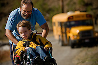 JEROME A. POLLOS/Press..Bruce Hess pushes his son Alex up the driveway of his house near Hauser Lake after school Oct. 16.
