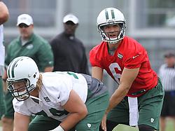 June 14, 2012; Florham Park, NJ, USA; New York Jets quarterback Mark Sanchez (6) takes a snap from New York Jets center Nick Mangold (74) during New York Jets Minicamp at the Atlantic Health Training Center.