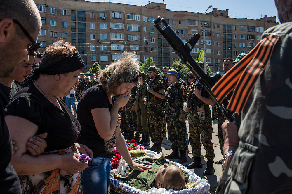 Friends and relatives grieve over the body of Aleksandr Politov, a pro-Russia militia fighter who was killed when his group attacked a Ukrainian military checkpoint two days earlier in the village of Blahodatne, outside the occupied city administration building on May 24, 2014 in Horlivka, Ukraine. Presidential elections are scheduled for tomorrow, but pro-Russia militias have been seeking to prevent them from being administered throughout the eastern part of the country.