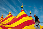 """Members of the Cole Bros. Circus work to raise the Big Top during a stop in Gaithersburg Maryland. The Cole Bros. Circus of the Stars is celebrating its 127th season and bills itself as the """"World's Largest Circus Under The Big Top."""""""