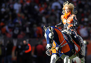 SHOT 1/8/12 3:16:58 PM - Ann Judge-Wegener rides Thunder, the Denver Broncos mascot, across the field prior to a game against the Pittsburgh Steelers during their AFC Wildcard game at Sports Authority Field at Mile High on Sunday January 8, 2012.  (Photo by Marc Piscotty / © 2012)