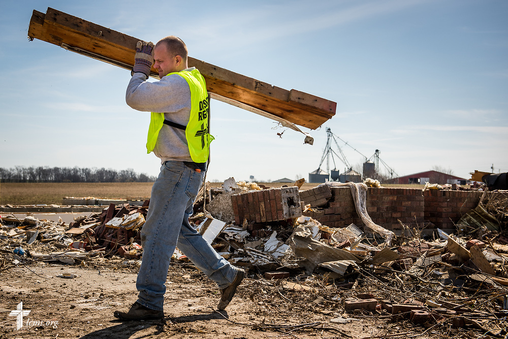 Volunteer Chris Adams of New Beginnings Lutheran Church, Pacific, Mo., moves debris from a damaged home on Saturday, March 4, 2017, in Perryville, Mo. LCMS Communications/Erik M. Lunsford