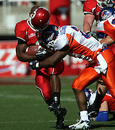 A hit by Boise State's Gerald Alexander popped the helmet off of the University of Utah's Darryl Poston in the second half at Rice-Eccles Stadium  in Salt Lake City on Saturday afternoon.