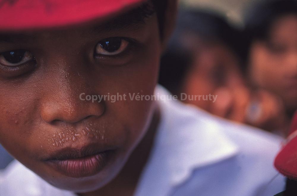 """Book """"Fleur de peau"""", p.162-163.Schoolboy from the Togian Island in Sulawesi, Indonesia...Livre """"Fleur de peau"""", p. 162-163.Ecolier des Iles Togian, à Sulawesi, en Indonésie."""