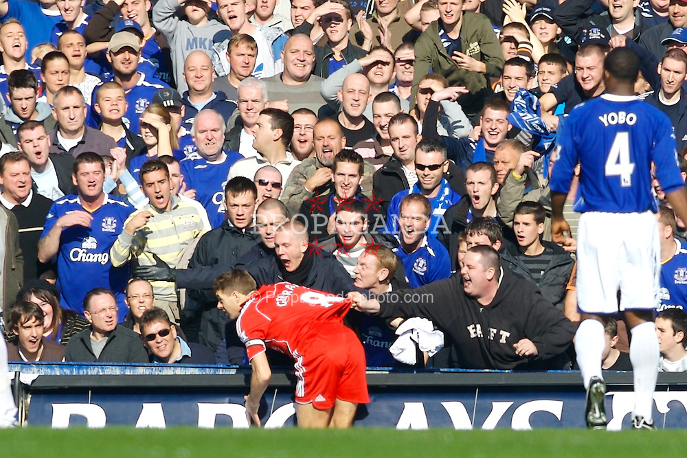 Liverpool, England - Saturday, October 20, 2007: Liverpool's captain Steven Gerrard MBE falls into the aggressive Everton crowd at the Gwladys Street during the 206th Merseyside Derby match at Goodison Park. (Photo by David Rawcliffe/Propaganda)
