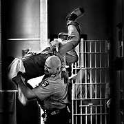 "Some inmates ask ""Weekday jailer, weekend wrestler"" officer Don Lang to ""show them some moves"" so he'll occasionally scoop someone up in a playful bodyslam type fashion."
