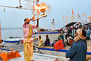 A dawn puja (a Hindu religious ritual of worship), where  light is offered to one or more deitiesdispels darkness,  this perfomance dates back to the Vedic time (circa 2000 BCE).