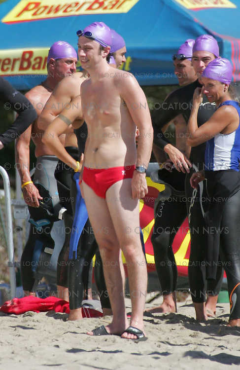 "September 28, 2005 Malibu, CA. **EXCLUSIVE** Zach Braff films a funny scene for an episode of Scrubs titled ""My Day At The Races"". In this scene Zach's character competes in a triathlon but the water is to cold for him. Sales: Eric Ford 1/818-613-3955 info@onlocationnnews.com"