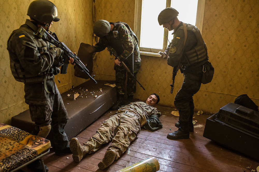 YAVORIV, UKRAINE - APRIL 30, 2015: Ukrainian soldiers detain a suspect during in a mock house raid, a component of military training directed by the U.S. Army's 173rd Airborne Brigade as part of Operation Fearless Guardian at the Yavoriv training center near Yavoriv, Ukraine. Around 300 American soldiers are training an equivalent number of Ukrainians during each of three eight-week programs to improve their ability to combat Russian-backed rebels in the country's east. CREDIT: Brendan Hoffman for The New York Times