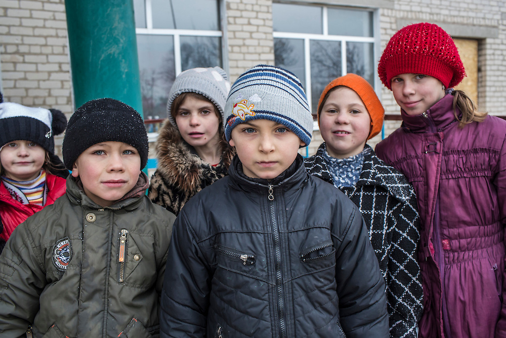 Students pose for a picture outside their school on Friday, December 11, 2015 in Troitske, Ukraine.