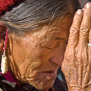 Buddhist woman praying in Ladakh (Little Tibet), India