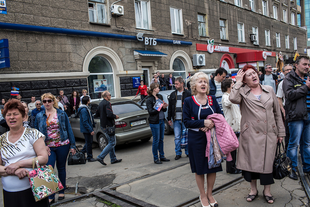 People attend a pro-Russian demonstration which took over a local police station on Thursday, May 1, 2014 in Donetsk, Ukraine.