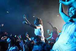 Ethiopian women cheer Teddy Afro, their country's most popular musician, at a concert in Beirut.