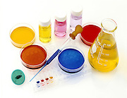 lab tools, products and chemicals on white background